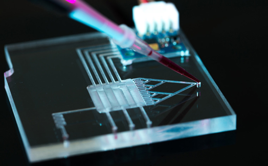 Characterization of microchannels fabricated with laser for microfluidic applications